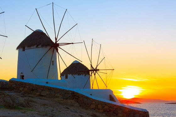Mykonos Island, showing wind mils with a sunset.